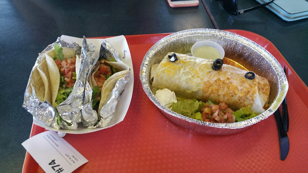 Shrimp and fish tacos on the left and grilled fish burrito for Best fish tacos near me