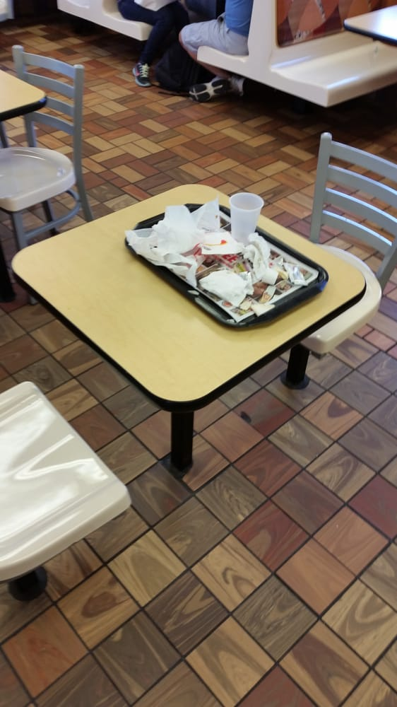 Disgusting dirty tables all over the dining area at this for Table burger