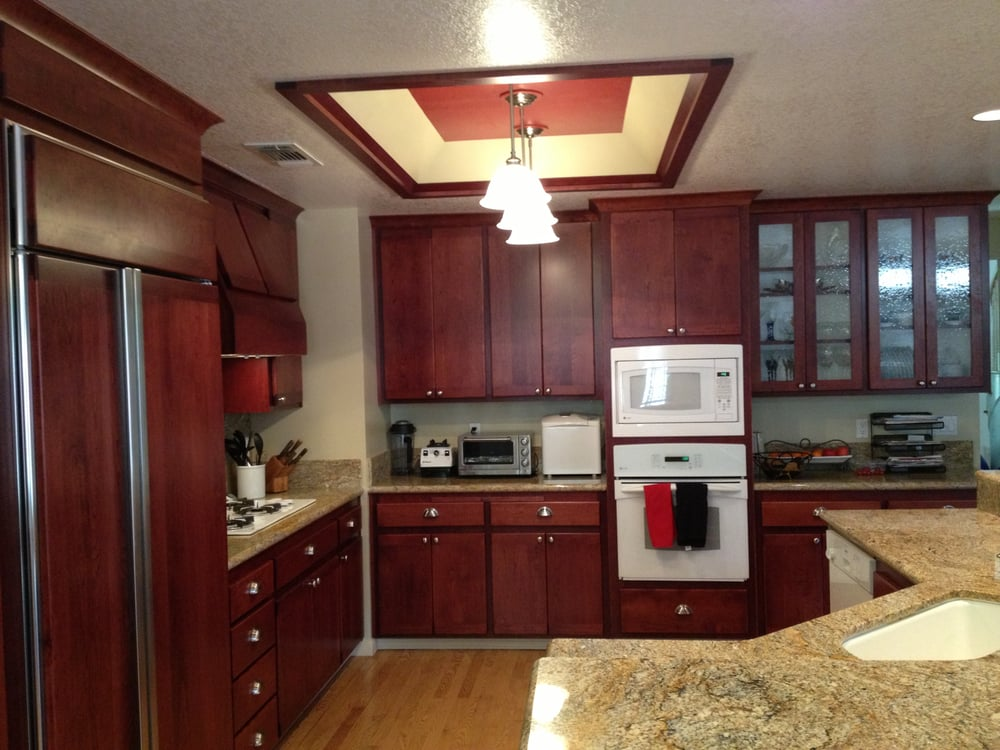 cherry wood kitchen cabinets resurfacing project included refrigerator door panels and. Black Bedroom Furniture Sets. Home Design Ideas